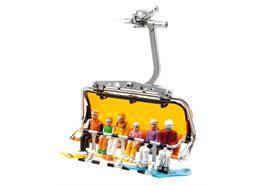 Set de 6 figures assises avec des snowboards HEAD